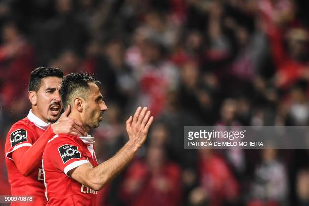 Benfica's Brazilian forward Jonas Oliveira celebrates a goal with teammate Benfica's defender Andre Almeida during the Portuguese league football...