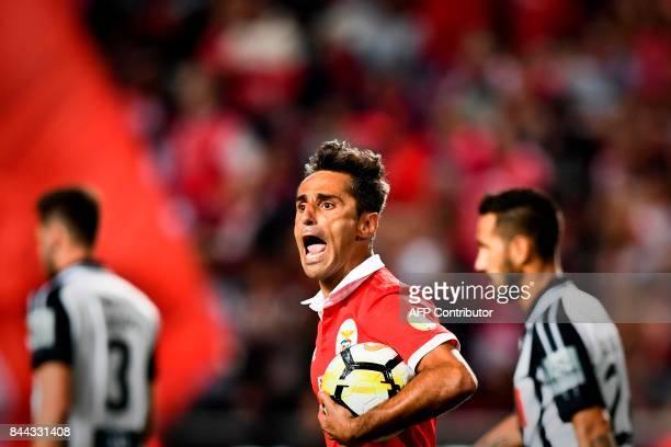 Benfica's Brazilian forward Jonas Oliveira celebrates after scoring on a penalty kick during the Portuguese league football match SL Benfica vs...
