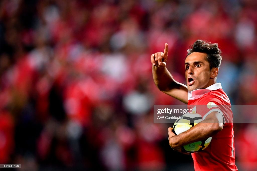 Benfica's Brazilian forward Jonas Oliveira celebrates after scoring on a penalty kick during the Portuguese league football match SL Benfica vs Portimonense SAD at the Luz stadium in Lisbon on September 8, 2017. /