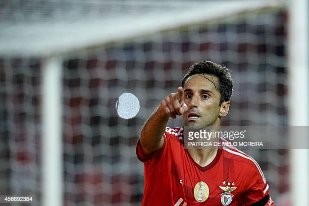 Benfica's Brazilian forward Jonas Oliveira celebrates after scoring during the Portuguese Liga football match Benfica vs Arouca at Luz stadium in...