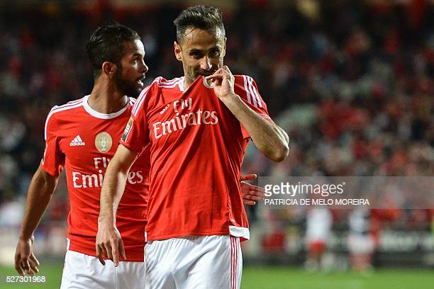 Benfica's Brazilian forward Jonas Oliveira celebrates with his teammate Benfica's Belgian midfielder Mehdi CarcelaGonzalez after scoring during the...
