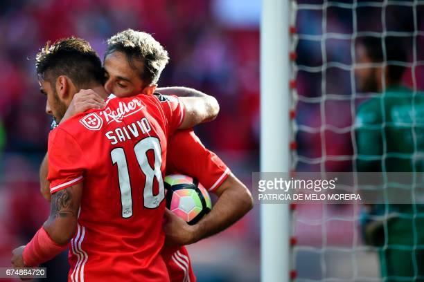 Benfica's Brazilian forward Jonas Oliveira celebrates with his teammate Benfica's Argentine midfielder Eduardo Salvio after scoring during the...
