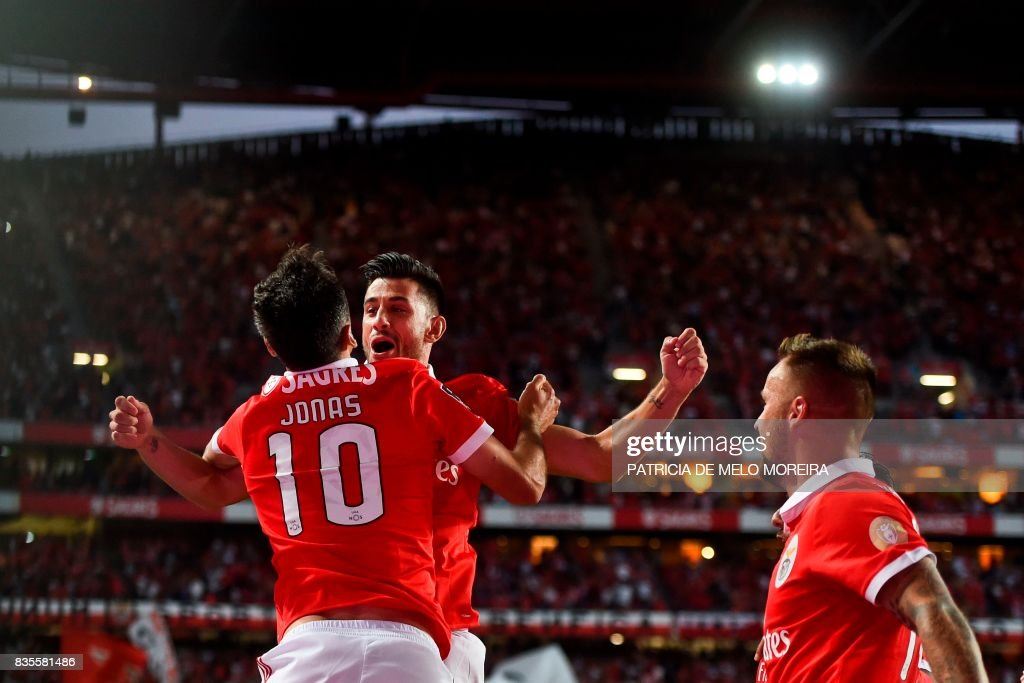 Benfica's Brazilian forward Jonas Oliveira (L) celebrates with his teammate Benfica's midfielder Pizzi Fernandes (2nd L) after scoring during the Portuguese League football match SL Benfica vs CF Os Belenenses at the Luz stadium on August 19, 2017. /