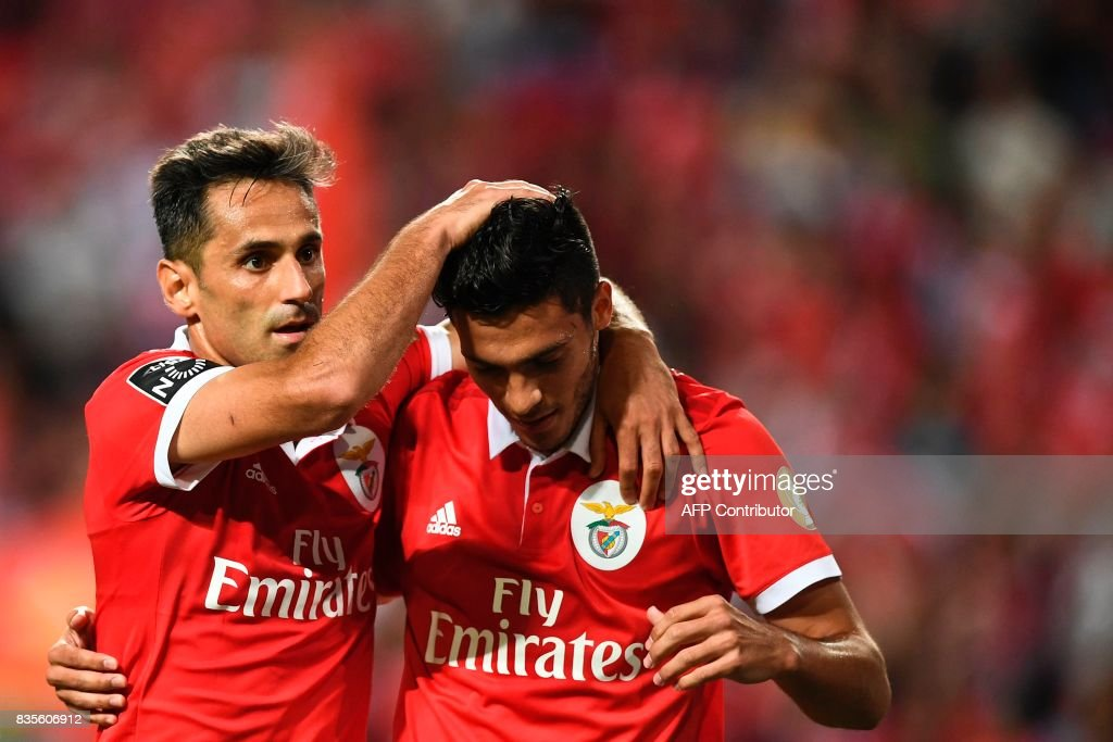 Benfica's Brazilian forward Jonas Oliveira (L) celebrates with his teammate Benfica's Mexican forward Raul Jimenez (R) after scoring during the Portuguese League football match SL Benfica vs Os Belenenses at Luz stadium on August 19, 2017. /