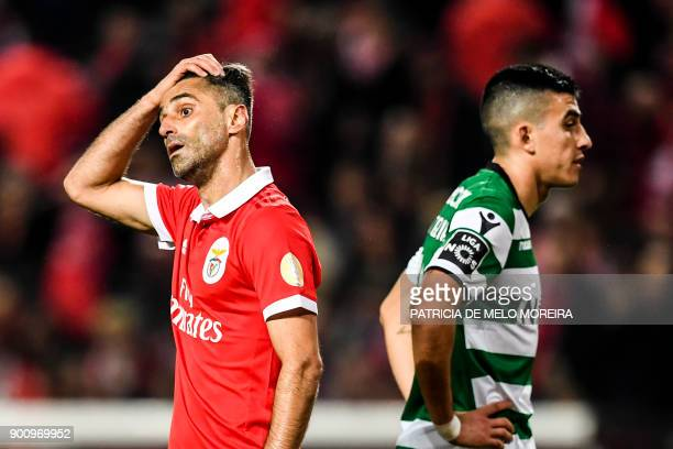 Benfica's Brazilian forward Jonas Oliveira gestures beside Sporting's Argentinian midfielder Rodrigo Battaglia during the Portuguese league football...