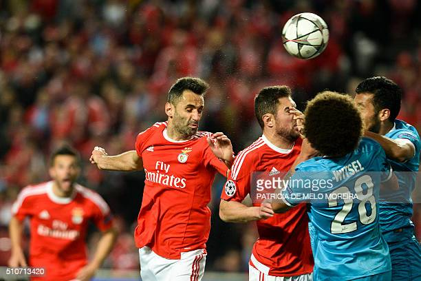 Benfica's Brazilian forward Jonas Oliveira heads the ball to score a goal during the UEFA Champions League round of 16 football match SL Benfica vs...