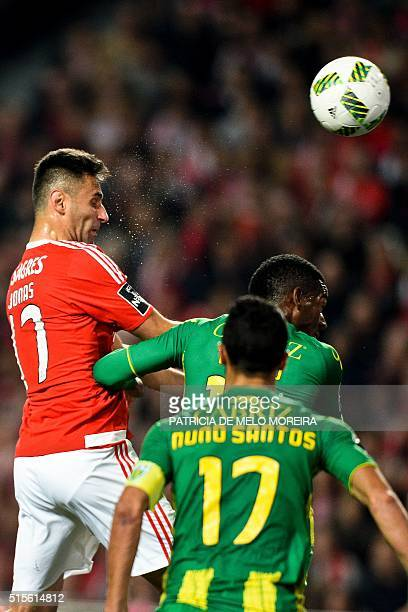 Benfica's Brazilian forward Jonas Oliveira heads the ball to score a goal during the Portuguese league football match SL Benfica vs CD Tondela at the...