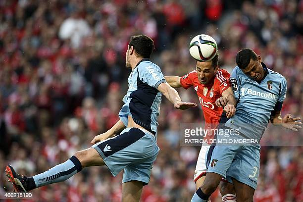 Benfica's Brazilian forward Jonas Oliveira heads the ball with Braga's Brazilian defender Aderlan Santos during the Portuguese league football match...