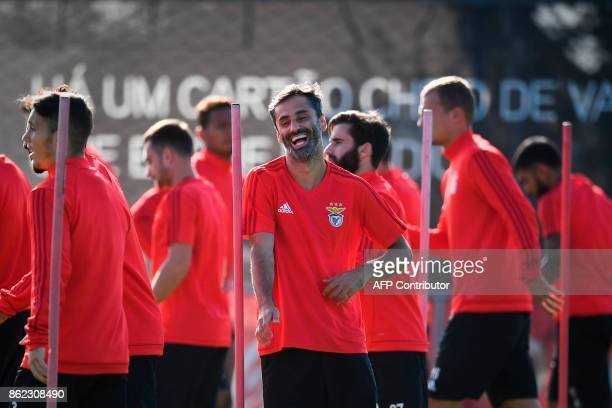 Benfica's Brazilian forward Jonas Oliveira laughs during a training session at the club's training ground in Seixal in the outskirts of Lisbon on...
