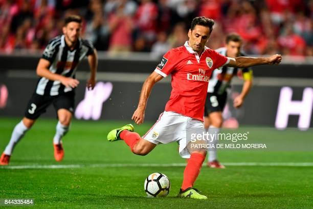 Benfica's Brazilian forward Jonas Oliveira makes a penalty kick during the Portuguese league football match SL Benfica vs Portimonense SAD at the Luz...