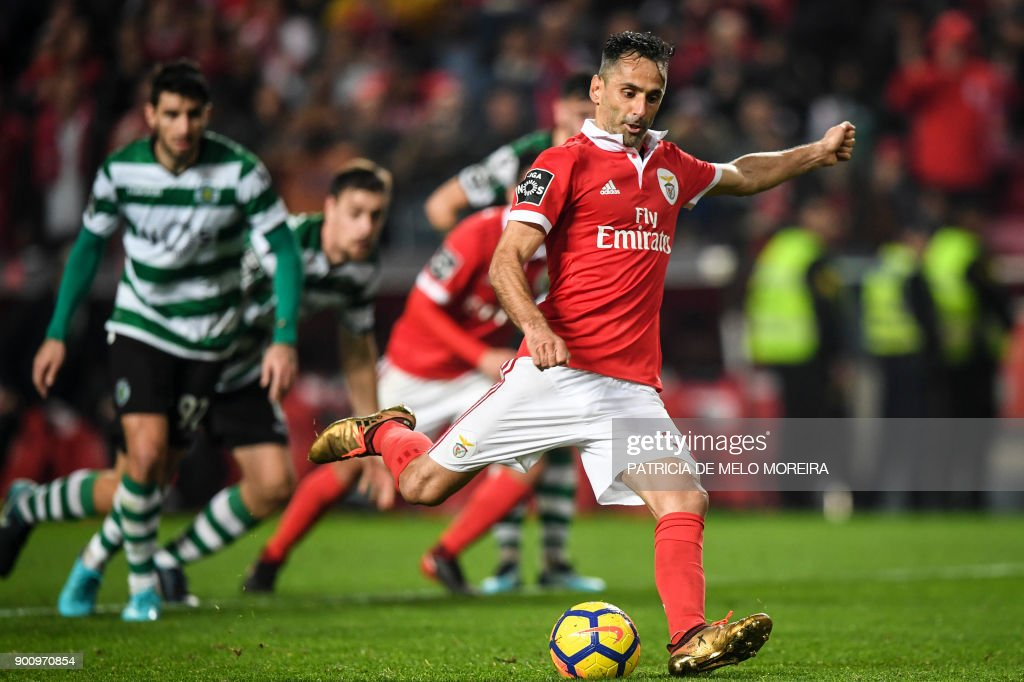 Benfica's Brazilian forward Jonas Oliveira shoots a penalty kick during the Portuguese league football match SL Benfica vs Sporting CP at the Luz stadium in Lisbon on January 3, 2018. /