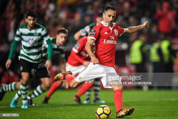 Benfica's Brazilian forward Jonas Oliveira shoots a penalty kick during the Portuguese league football match SL Benfica vs Sporting CP at the Luz...