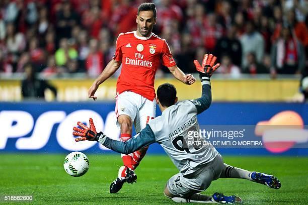 Benfica's Brazilian forward Jonas Oliveira vies with Braga's Brazilian goalkeeper Matheus Magalhaes during the Portuguese Liga football match Benfica...