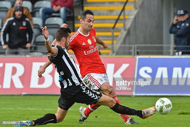 Benfica's Brazilian forward Jonas Oliveira vies with Nacional's forward Luis Aurelio during the Portuguese league football match CD Nacional vs SL...