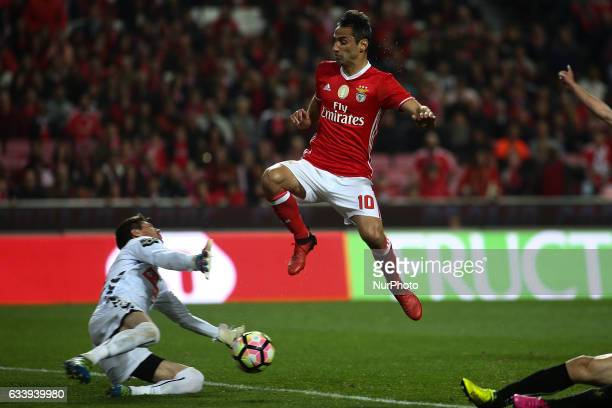 Benfica's Brazilian forward Jonas Oliveira vies with Nacional's goalkeeper Adriano Facchini during the Portuguese League football match between SL...
