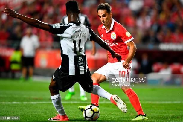 Benfica's Brazilian forward Jonas Oliveira vies with Portimonense's Ghanaian defender Emmanuel Hackman during the Portuguese league football match SL...