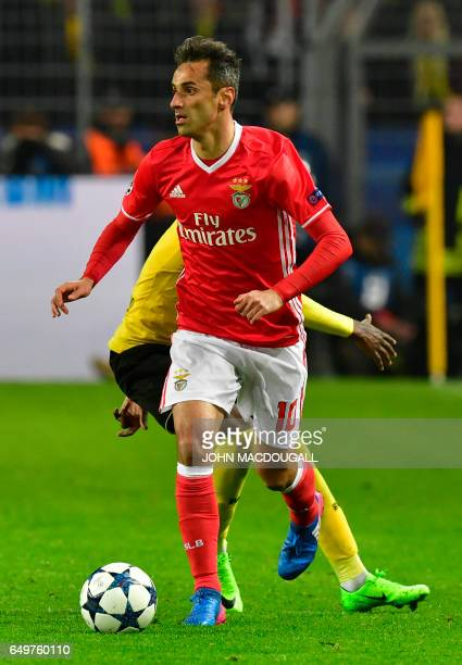 Benfica's Brazilian forward Jonas runs with the ball during the UEFA Champions League Round of 16 2ndleg football match Borussia Dortmund v SL...