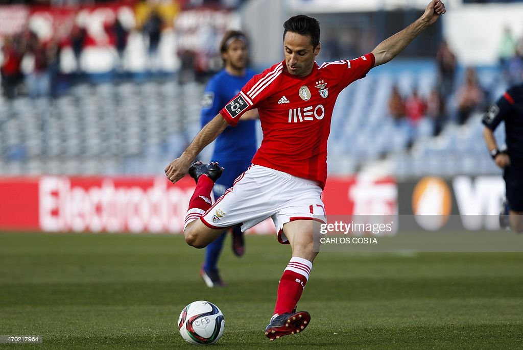 Benfica's Brazilian forward Jonas scores a goal during the Portuguese league football match CF Os Belenenses v SL Benfica at the Restelo stadium in Lisbon on April 18, 2015.