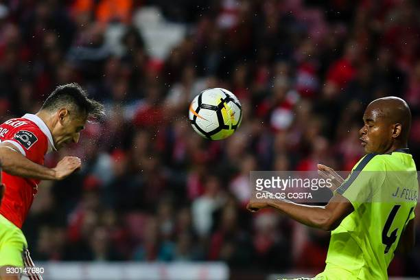 Benfica's Brazilian forward Jonas vies with Aves' Brazilian defender Jorge Felipe during the Portuguese league football match between SL Benfica and...