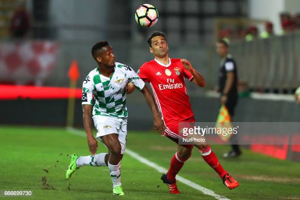 Benfica's Brazilian forward Jonas vies with Moreirense's defender Pierre Sagna during the Premier League 2016/17 match between Moreirense FC and SL...