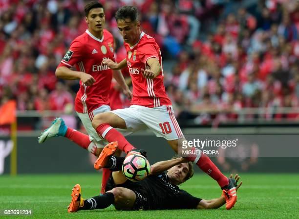 Benfica's Brazilian forward Jonas vies with Vitoria Guimaraes' midfielder Rafael Miranda during the Portuguese league football match SL Benfica vs...
