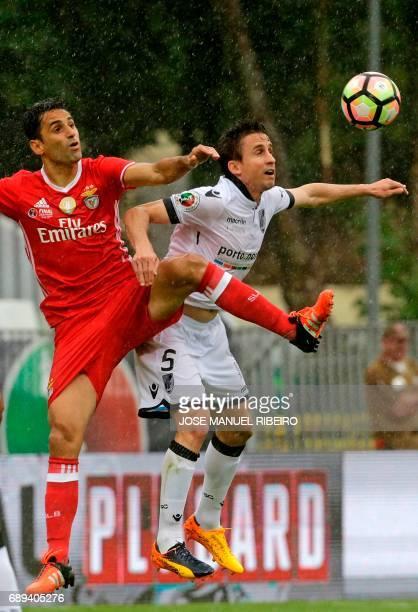 Benfica's Brazilian forward Jonas vies with Vitoria Guimaraes' Brazilian midfielder Rafael Miranda during the Portugal's Cup final football match SL...