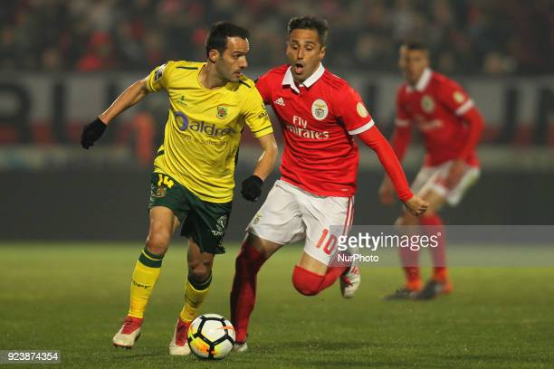 Benfica's Brazilian forward Jonas with Pacos Ferreira's Portuguese defender Ruben Micael during the Premier League 2017/18 match between Pacos...