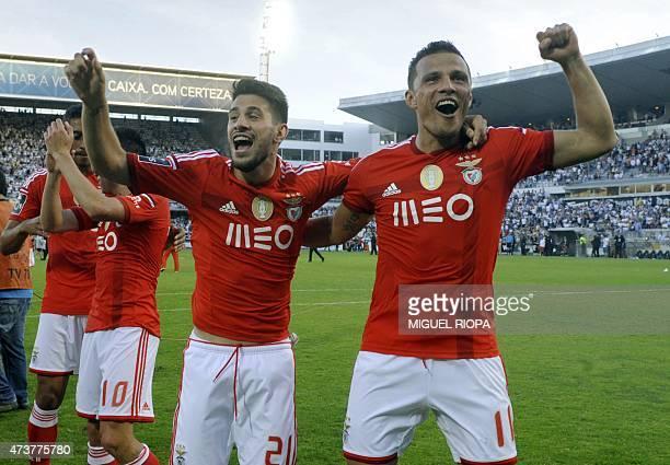 Benfica's Brazilian forward Rodrigo Lima and midfielder Pizzi celebrate at the end of the Portuguese league football match Vitoria SC vs SL Benfica...