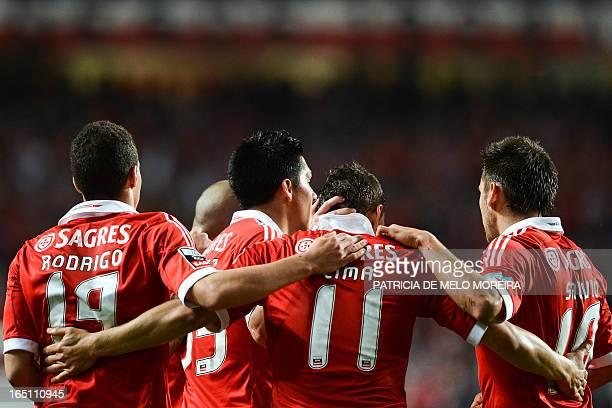 Benfica's Brazilian forward Rodrigo Lima celebrates with his teammates after scoring during the Portuguese League football match Benfica vs Rio Ave...