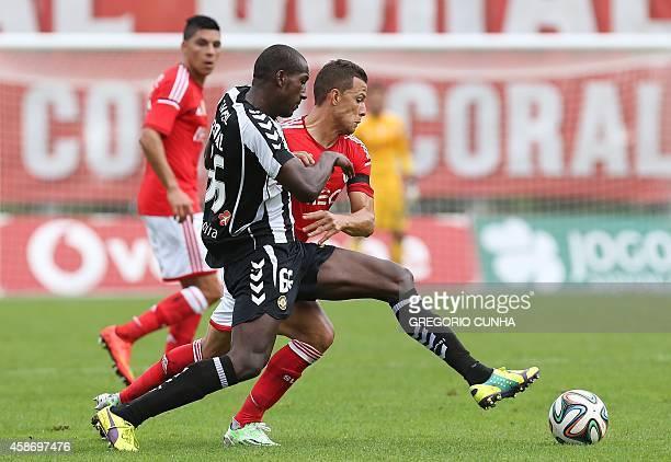 Benfica's Brazilian forward Rodrigo Lima vies with Nacional's Egyptian midfielder Aly Ghazal during the Portuguese league football match CD Nacional...
