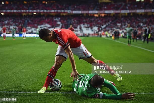 Benfica's Brazilian forward Rodrigo Lima vies with Rio Ave's Peruvian defender Alberto Rodriguez during the Portuguese league football match Benfica...