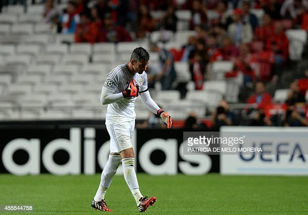 Benfica's Brazilian goalkeeper Artur Moraes leaves the pitch after receiving a red card during the UEFA Champions League group C football match SL...