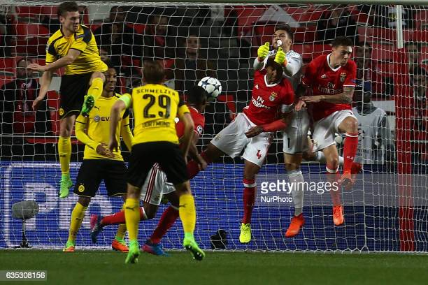 Benfica's Brazilian goalkeeper Ederson Moraes saves the ball during the Champions League football match between SL Benfica and Borussia Dortmund at...