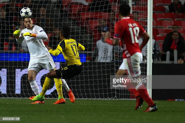 Benfica's Brazilian goalkeeper Ederson Moraes vies with Dortmund's forward Aubameyang during the Champions League football match between SL Benfica...