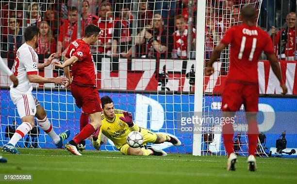 Benfica's Brazilian goalkeeper Ederson save the ball during the Champions League quarterfinal firstleg football match between Bayern Munich and...