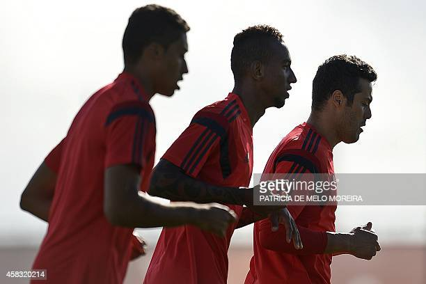 Benfica's Brazilian goalkeeper Julio Cesar Benfica's Brazilian forward Anderson Talisca and Benfica's Brazilian defender Cesar Martins take part in a...