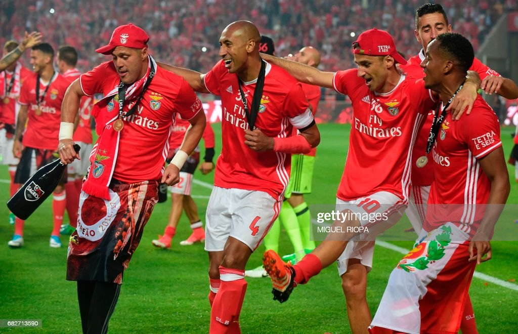 Benfica's Brazilian goalkeeper Julio Cesar, Brazilian defender Luisao, Brazilian forward Jonas and Peruvian forward Andre Carrillo celebrate after winning their 36th title at the end of the Portuguese league football match SL Benfica vs Vitoria Guimaraes SC at the Luz stadium in Lisbon on May 13, 2017. Lisbon giants Benfica clinched a fourth straight Portuguese league title on May 13, 2017 with a 5-0 victory over Vitoria Guimaraes. The champions have an unassailable 81 points from 33 games and cannot be caught by Porto, who are eight points behind with just two games to play. /