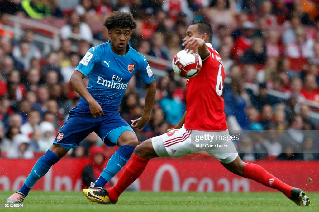 Benfica's Brazilian midfielder Filipe Augusto (R) commits a hand-ball as Arsenal's English midfielder Reiss Nelson tries to pass the ball during the pre-season friendly football match between Arsenal and Benfica at The Emirates Stadium in north London on July 29, 2017, the game is one of four matches played over two days for the Emirates Cup. / AFP PHOTO / Ian KINGTON / RESTRICTED TO EDITORIAL USE. No use with unauthorized audio, video, data, fixture lists, club/league logos or 'live' services. Online in-match use limited to 75 images, no video emulation. No use in betting, games or single club/league/player publications. /
