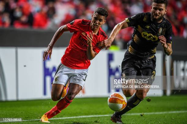 Benfica's Brazilian midfielder Pedrinho challenges Standard Liege's French defender Nicolas Gavory during the UEFA Europa League group D football...