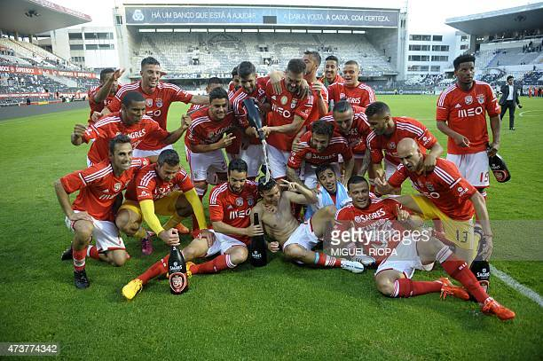 Benfica's Brazilian players celebrate at the end of the Portuguese league football match Vitoria SC vs SL Benfica at the Dom Afonso Henriques stadium...