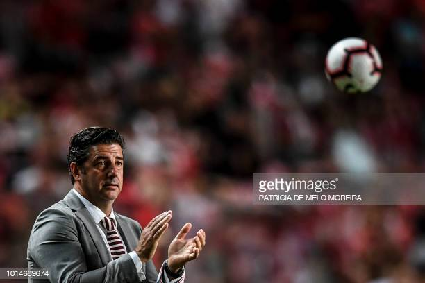 Benfica's coach Rui Vitoria claps during the Portuguese league football match between SL Benfica and Vitoria Guimaraes SC at the Luz stadium in...
