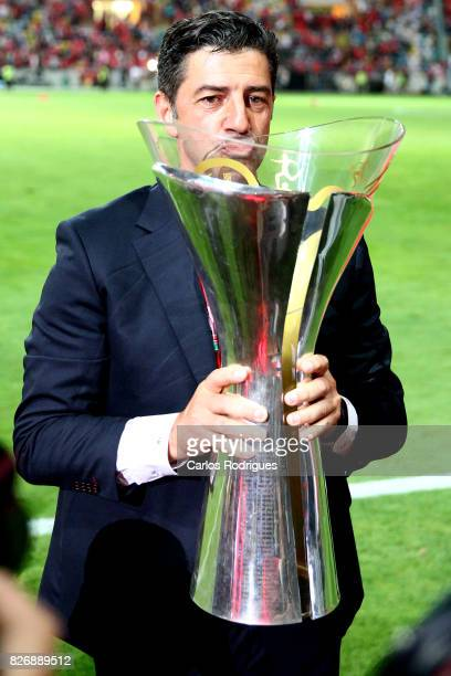 Benfica's coach Rui Vitoria from Portugal with the Portuguese Super Cup trophy after the match between SL Benfica and VSC Guimaraes at Estadio...