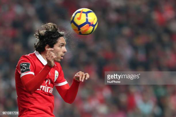 Benfica's Croatian forward Filip Krovinovic heads the ball during the Portuguese League football match SL Benfica vs Sporting CP at the Luz stadium...