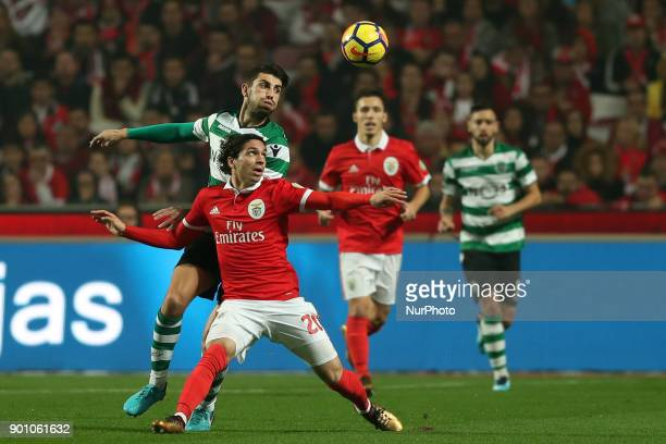Benfica's Croatian forward Filip Krovinovic vies with Sporting's defender Cristiano Piccini from Italy during the Portuguese League football match SL...