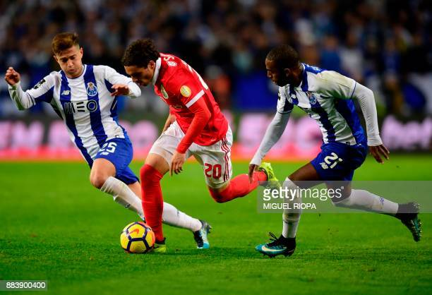 Benfica's Croatian midfielder Filip Krovinovic controls the ball between Porto's Brazilian midfielder Otavio and Porto's Portuguese defender Ricardo...