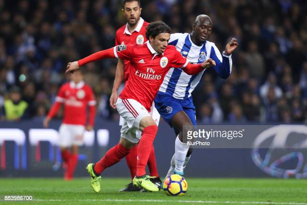 Benfica's Croatian midfielder Filip Krovinovic in action with Porto's Portuguese midfielder Danilo Pereira during the Premier League 2016/17 match...