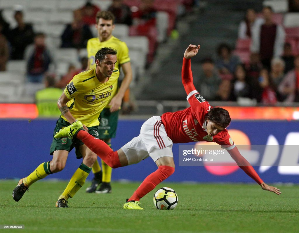 Benfica's Croatian midfielder Filip Krovinovic (R) vies with Pacos Ferreira's Australian forward Awer Mabil during the Portuguese league football match SL Benfica vs FC Pacos de Ferreira at the Luz stadium in Lisbon on September 23, 2017. /