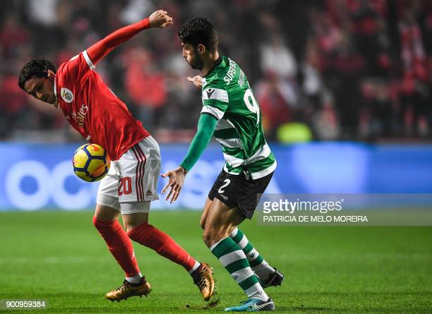 Benfica's Croatian midfielder Filip Krovinovic vies with Sporting's Italian defender Cristiano Piccini during the Portuguese league football match SL...