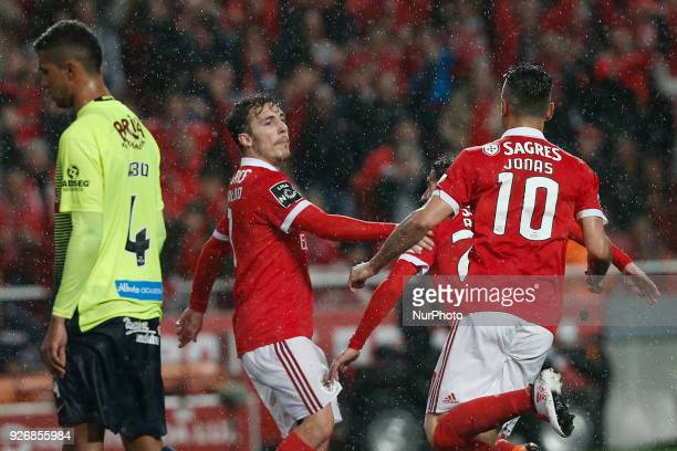 Benfica's defender Alejandro Grimaldo celebrates his goal with Benfica's forward Jonas during Primeira Liga 2017/18 match between SL Benfica vs CS...