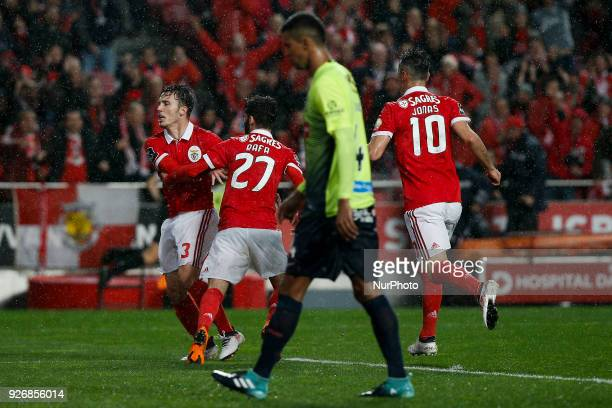 Benfica's defender Alejandro Grimaldo celebrates his goal with Benfica's midfielder Rafa Silva and Benfica's forward Jonas during Primeira Liga...